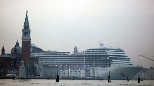 A cruise ship sails in the Venice lagoon near St. Mark's Square in Venice